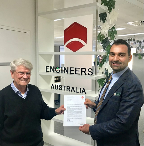 Council's Manager, Assets and Design, Dr Atheer Al-Saoudi receiving his interim Certificate from the Chair of Engineers Australia Chartered Assessment Panel.