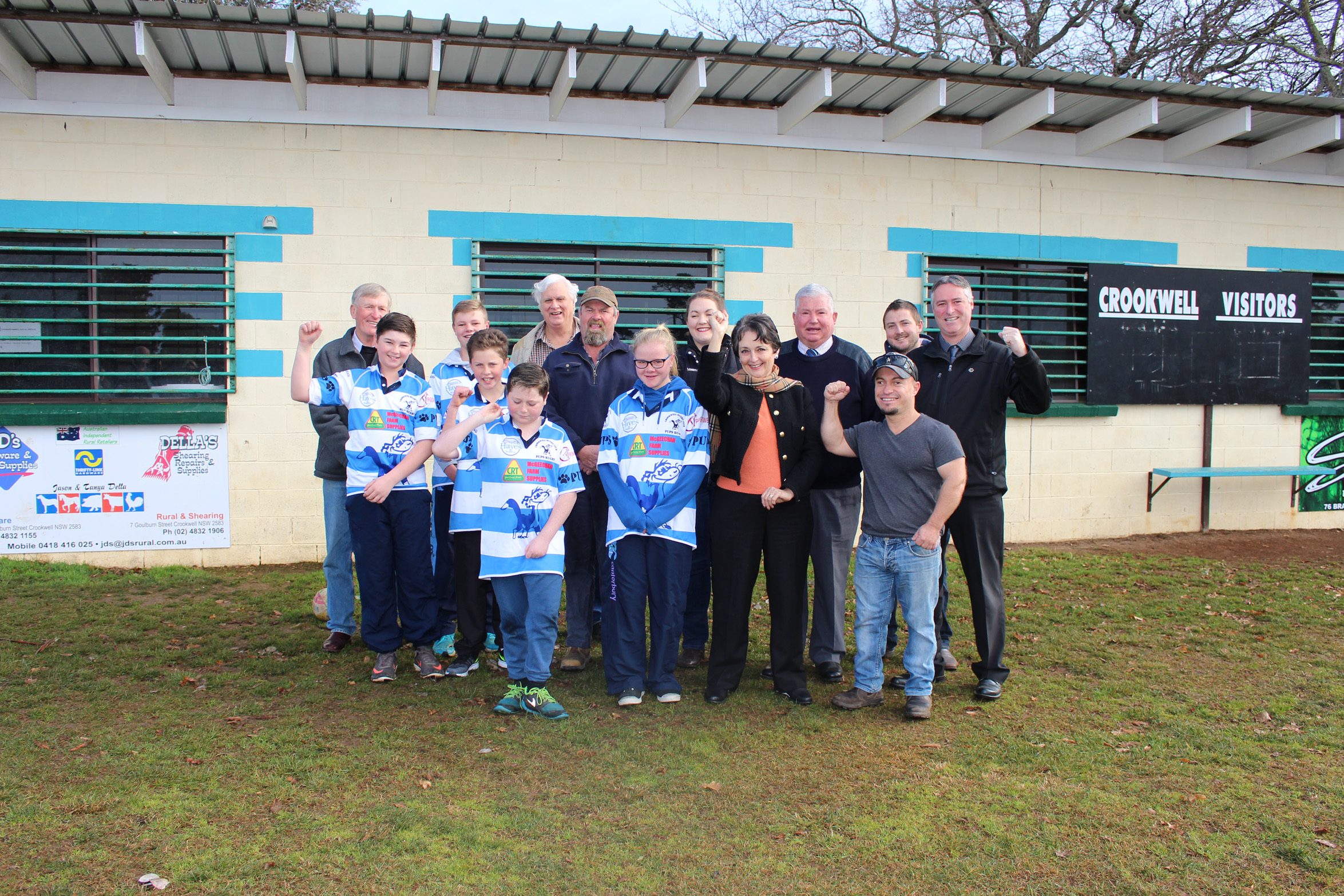 L-R: Barbell Club President John Broderick, The Pups' Lachlan Vallender, Jack Page, Angus Smith and Logan Croke, Crookwell Rotary Club Secretary Peter Cullen, Crookwell Junior Rugby Union's John McCue, The Pups' Emma Page, Crookwell Senior Rugby Club's Ally Horan, Member for Goulburn Pru Goward, Upper Lachlan Shire Council Mayor Brian McCormack OAM, Barbell Club Vice President Dan Wray, Crookwell Senior Rugby League's Mitch McGeechan and Council's Acting General Manager Andrew Croke celebrate.